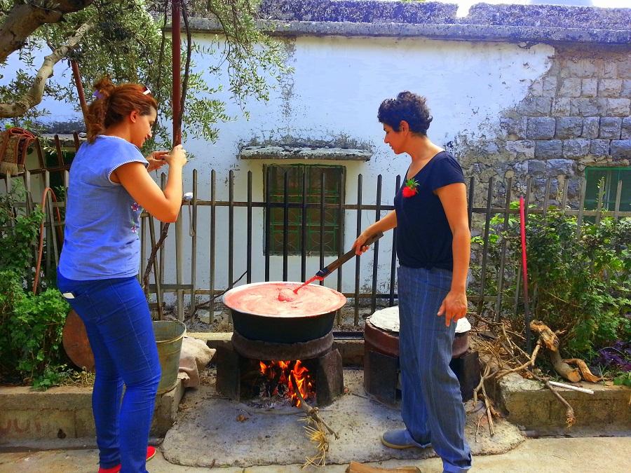 Visitors making tomato paste at Lina's
