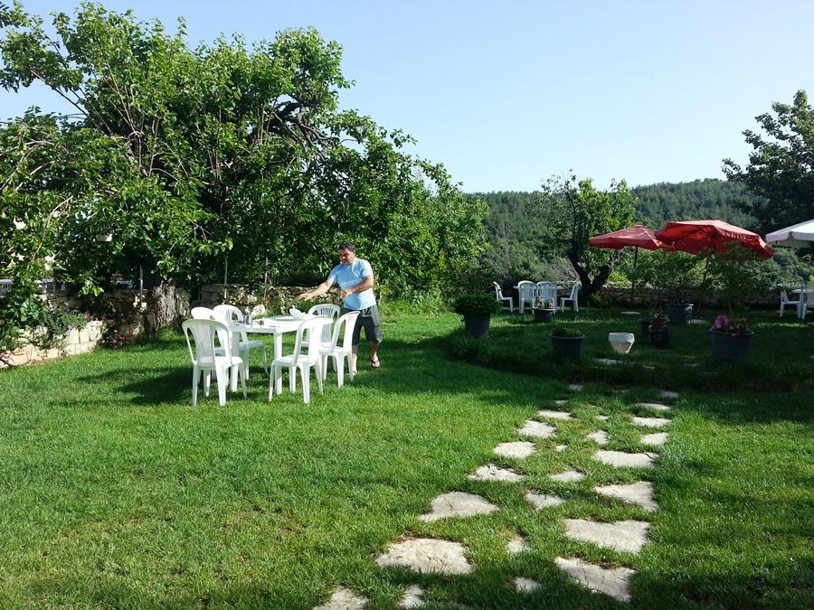 Salim preparing the backyard garden to receive his guests