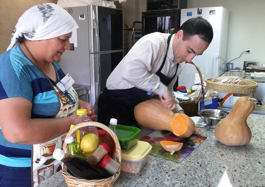 Alberto cutting and pealing the pumpkin
