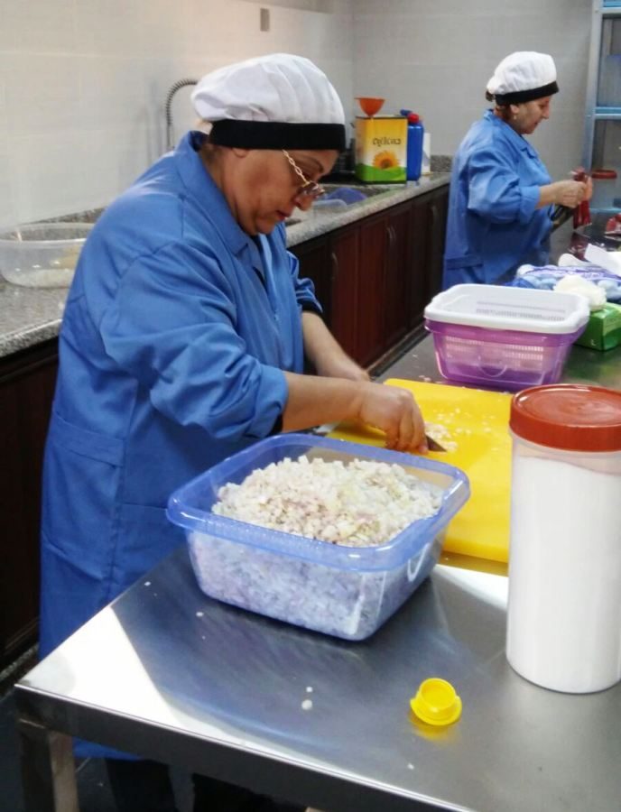 It's pasta cooking day in Tripoli community kitchen!