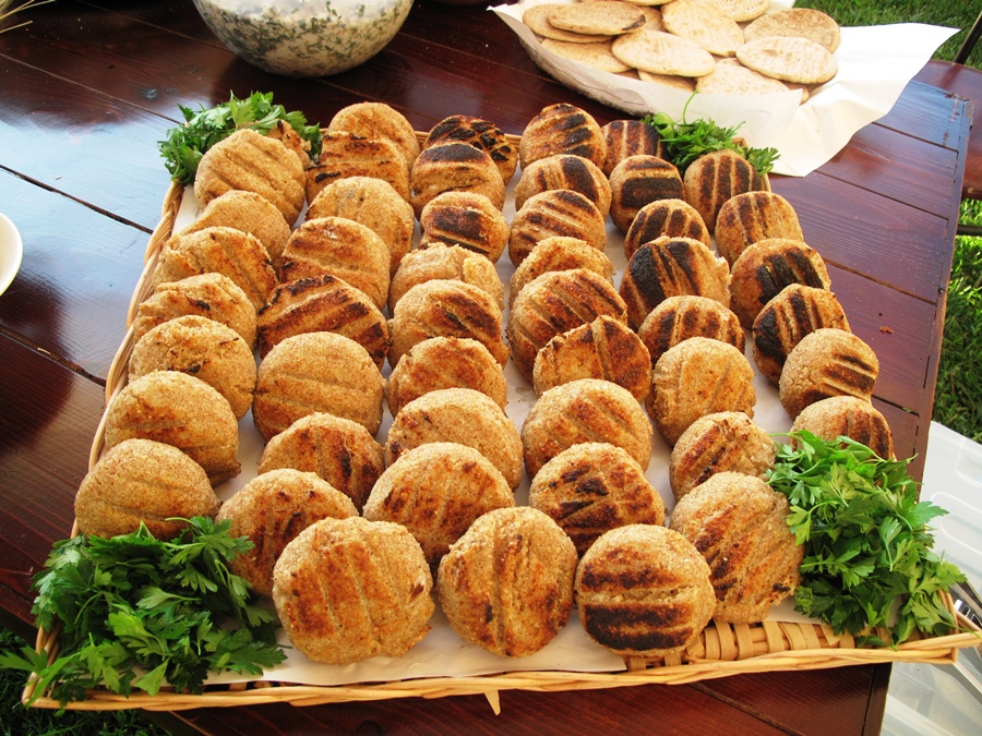 Potato kebbeh stuffed with labneh and grilled on charcoal