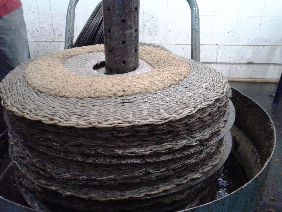 The traditional press: olive paste is spread on disks in order to extract oil